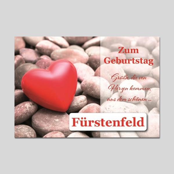 City-Cards rotes Herz auf Steinen